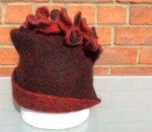 Hand felted hat made from black and red Bergschaf wool
